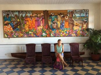 Anne in front of beautiful Tahitian art work