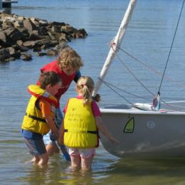 Charlie gets help launching his boat from two very little aspiring sailors