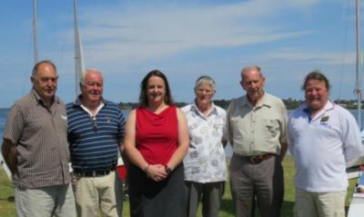 Life members Sandy, Bob and Elsie and Hal pose with Commodore Jacqui and past Commodore John on Opening Day