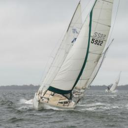 Mara with Drew Mynard plows through the weather in the Twilight Sail.  Some exciting blows out there on Tuesdays!