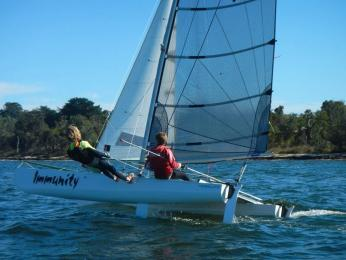 Oscar and Charlie fly out in the Youth Catamaran Sailing Clinic