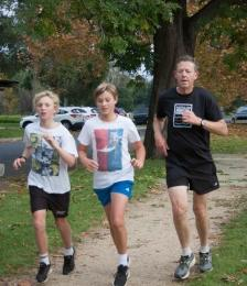 Gary works hard to keep up with Juniors Taj and Oskar at the Parkrun on Sunday.  Come create a GLYC winter team