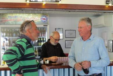 James and David confer at Sailors' Meeting while Ron manages the refreshment stand