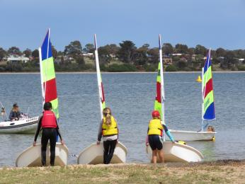 Kids bringing dinghies back from sailing.  They look good this Tackers group.