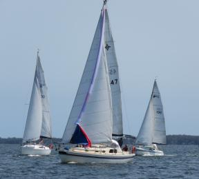 Lady skippers coming up to the rounding mark