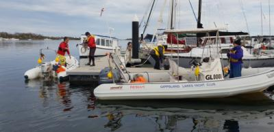 Rescue boat busyness before Winter Series.  Photo credit Wendy