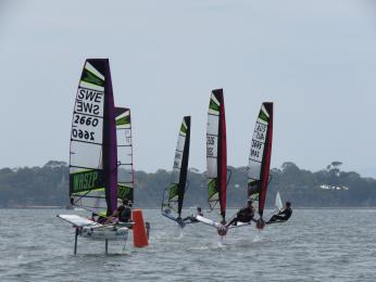 The fleet charges around the first mark in the Slalom course